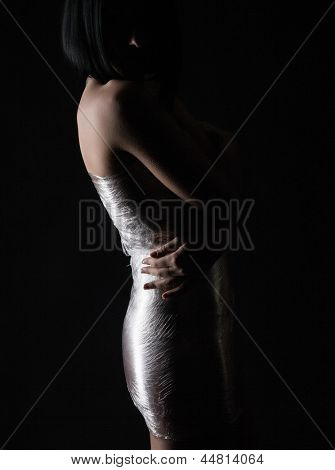 Young sexy woman on a black background
