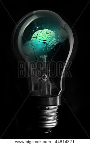 Blue brain inside light bulb on black background