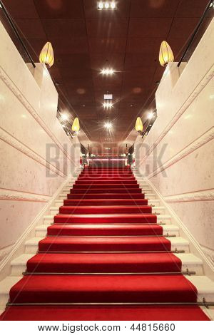 luxurious staircase with red carpet