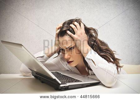 stressed businesswoman looks laptop