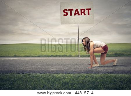 young woman is getting ready for a run