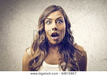 portrait of amazed woman with mouth open