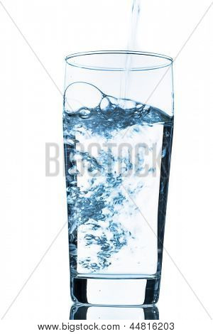 water is poured into a glass, symbolic photo for drinking water, freshness, demand and consumption