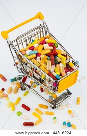 colorful tablets in the cart, photo icon for health costs, pharmacies, abundance of drugs
