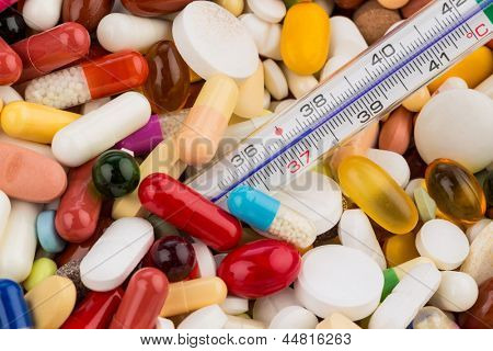 thermometer and tablets, symbolic photo for disease and medication