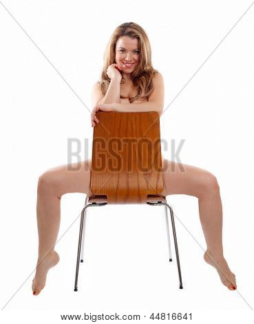 Beautiful Blond Young Woman Sat Naked On A Wooden Chair
