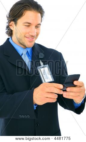 Smiling Young Caucasian Businessman Holding Pager