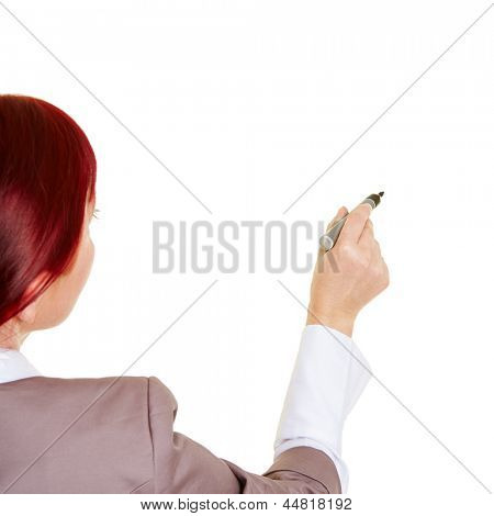 Business woman from behind writing with pen