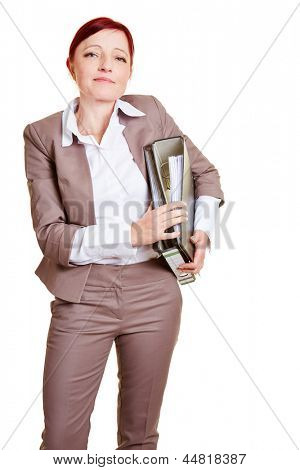 Elderly business woman with red hair carrying files