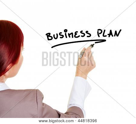 Woman writing the word Business Plan with a pen