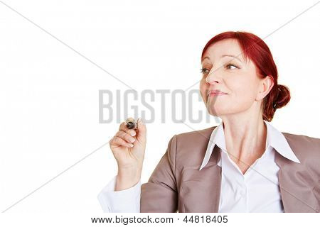 Business woman writing with pen into the air
