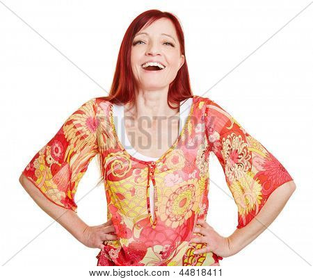 Happy best ager woman with her arms akimbo