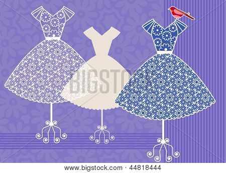 Pretty dresses in a row with bird