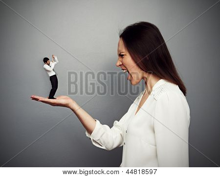 concept photo of big boss screaming at the small subordinate