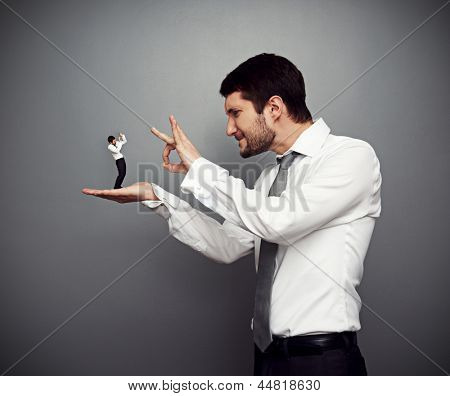 concept photo of wicked boss kicking out of the employer