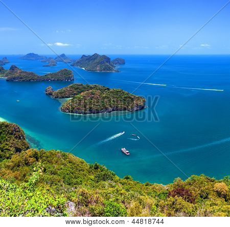 Angthong marine park near koh Samui, Thailand. Beautiful tropical island panoramic view with blue sky and water, exotic thai nature. Famous travel destination