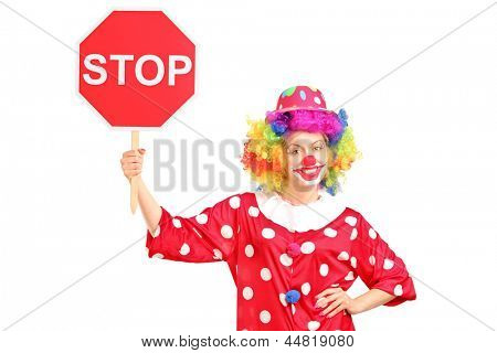 A clown holding a stop sign isolated against white background