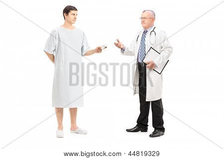Full length portrait of a male patient offering money to a doctor, isolated on white background
