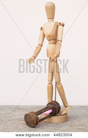 Wood Mannequin And Hourglass To Represent Unfortunately Time