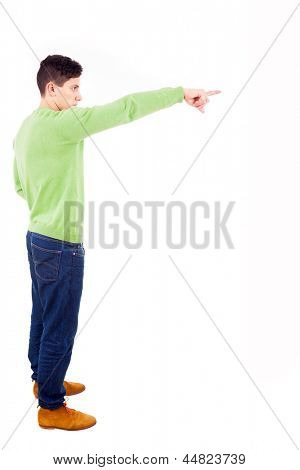 Young man pointing towards copyspace, isolated on a white background