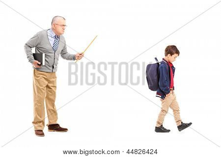 Full length portrait of an angry teacher shouting at a little schoolboy, isolated on white background
