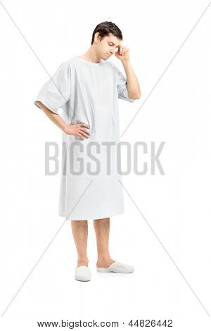 Full length portrait of a worried male patient, isolated on white background