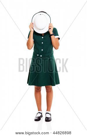 middle school student hiding her face with hat on white background