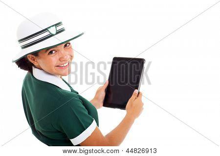 close up portrait of teen schoolgirl looking back holding tablet computer