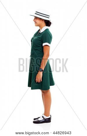 side view of a young teenage schoolgirl isolated on white background