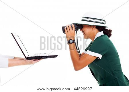 happy teen school girl using binoculars looking at computer screen