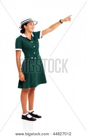 cheerful middle school student pointing up isolated on white background