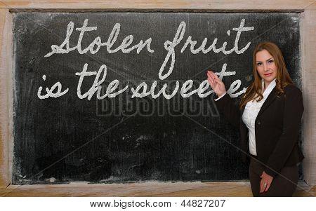 Teacher Showing Stolen Fruit Is The Sweetest On Blackboard