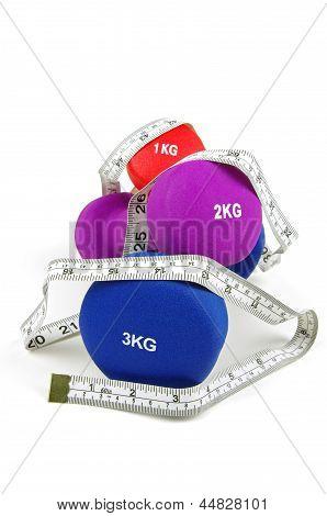 dumb bells and measuring tape