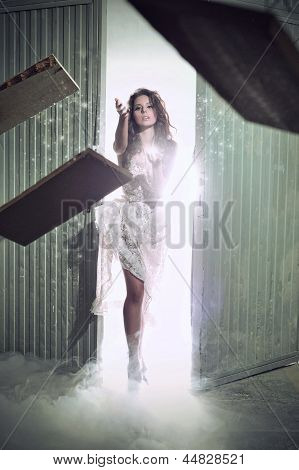 Young Woman Throwing Sticks In The Smoke