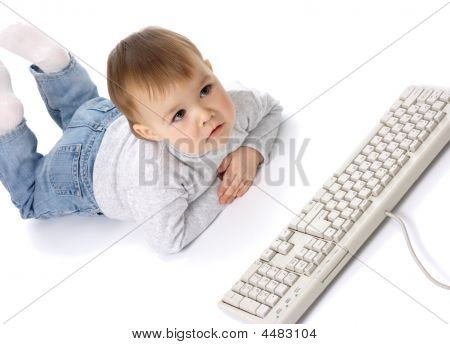 Cute Child Looking Carefully At A Monitor