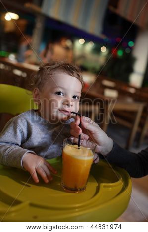 Toddler With Orange Juice