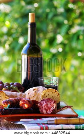 Meat, Bread And Wine On Table