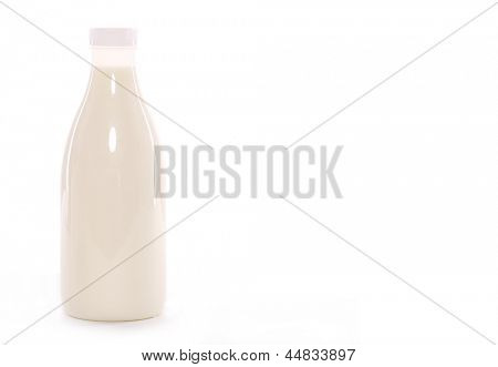 Bottle of milk with white cap isolated over white background