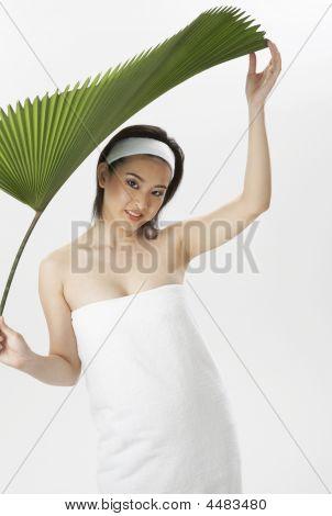 Woman Holding Big  Leaf