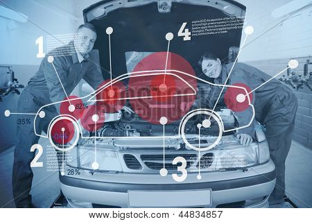 Two happy mechanics consulting futuristic interface with car diagram and statistics