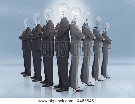 Businessman and businesswoman with light bulb heads multiplied posing on blue background