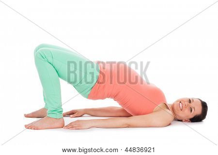 Beautiful pregnant woman working out isolated over white background