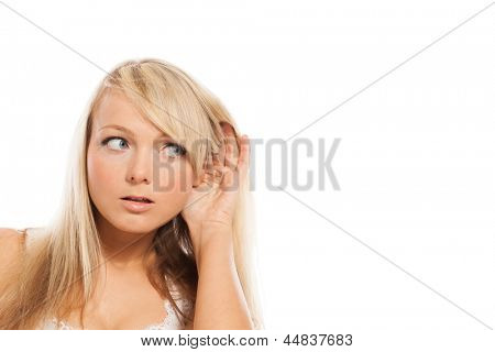 Young attractive woman holds hand at ear isolated over white background