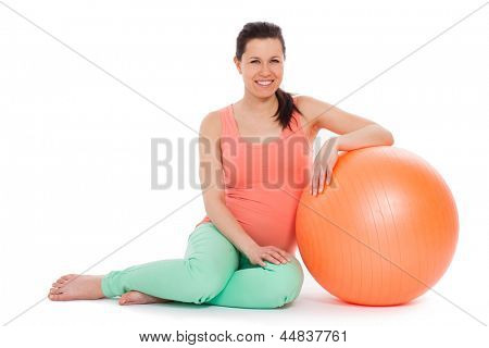 Beautiful pregnant woman with ball isolated over white background