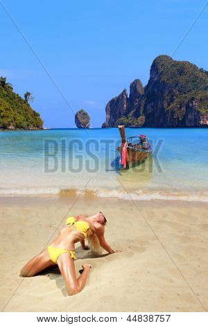 Young blonde woman on Phi Phi island beach in Thailand