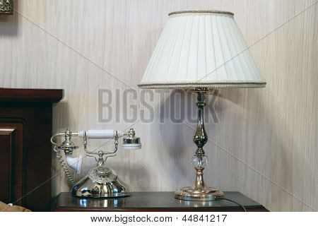 Table And Bedside Lamp With Telephone In The Interior