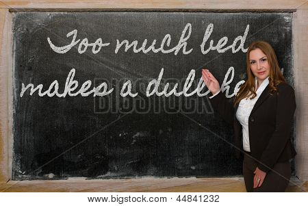 Teacher Showing Too Much Bed Makes A Dull Head On Blackboard