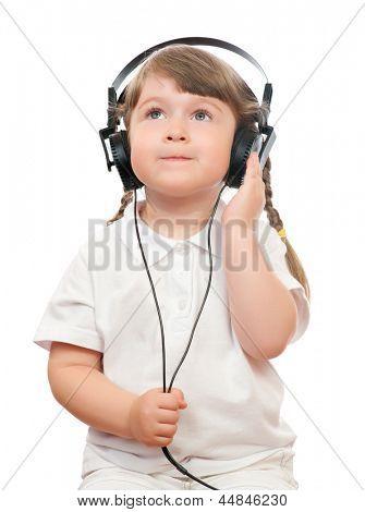 Little girl listen music by ear-phones