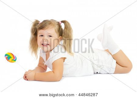 Little smiling girl with lollipop isolated