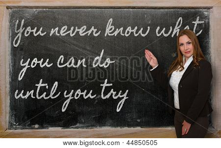 Teacher Showing You Never Know What You Can Do Until You Try On Blackboard